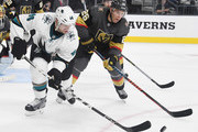 Marc-Edouard Vlasic #44 of the San Jose Sharks and Paul Stastny #26 of the Vegas Golden Knights go after the puck in the third period of their preseason game at T-Mobile Arena on September 30, 2018 in Las Vegas, Nevada. The Golden Knights defeated the Sharks 5-2.