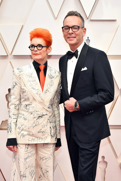 92nd Annual Academy Awards - Arrivals [fashion,red,yellow,suit,fashion design,eyewear,formal wear,event,outerwear,style,arrivals,sandy powell,christopher peterson,l-r,hollywood,california,highland,92nd annual academy awards,billy porter,red carpet,janelle mon\u00e1e,tuxedo,fashion,actor,92nd academy awards,celebrity,parasite]