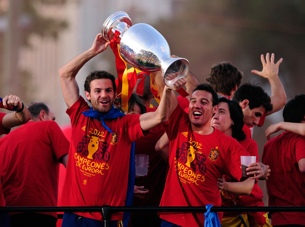 Santi Cazorla Juan Mata (L) and Santi Cazorla of Spain holds the UEFA EURO 2012 trophy aloft while celebrating with fellow players as they parade the UEFA EURO 2012 trophy on a double-decker bus on July 2, 2012 in Madrid, Spain. Spain beat Italy 4-0 in the UEFA EURO 2012 final match in Kiev, Ukraine, on July 1, 2012.