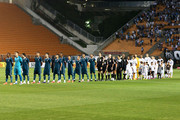 Players listening the National Anthem before a match between Santos and Goias of Brasileirao Series A 2014 at Pacaembu Stadium on September 28, 2014 in Sao Paulo, Brazil.