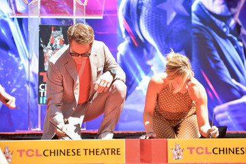 Scarlett Johansson Robert Downey Jr. Marvel Studios' 'Avengers: Endgame' Cast Place Their Hand Prints In Cement At TCL Chinese Theatre IMAX Forecourt