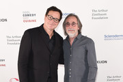 Bob Saget and Jackson Browne attend Scleroderma Research Foundation's Cool Comedy - Hot Cuisine New York 2018 at Caroline's on Broadway on December 11, 2018 in New York City.