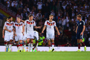 Thomas Mueller of Germany celebrates scoring his teams opening goal with team mate Toni Kroos during the UEFA EURO 2016 Qualifier Group D match between Scotland and Germany at Hampden Park on September 7, 2015 in Glasgow, Scotland.