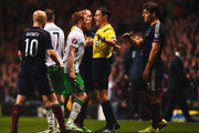Referee Milorad Mazic intervenes as Stephen Quinn of the Republic of Ireland (C) argues with Chris Martin of Scotland (13) during the EURO 2016 Group D Qualifier match between Scotland and Republic of Ireland at Celtic Park on November 14, 2014 in Glasgow, Scotland.