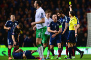 Scott Brown of Scotland appeals as referee Milorad Mazic issues a yellow card during the EURO 2016 Group D Qualifier match between Scotland and Republic of Ireland at Celtic Park on November 14, 2014 in Glasgow, Scotland.