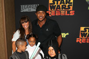 """Actor Pooch Hall (C) and his family attend the Screening of Disney XD's """"Star Wars Rebels: Spark of Rebellion"""" at the AMC Century City 15 theater on September 27, 2014 in Century City, California."""