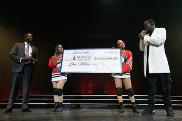 Sean Combs Sean 'Diddy' Combs Presents Howard University President Wayne A.I. Frederick With Special Donation Check