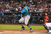 Denard Span #4 of the Seattle Mariners singles in the first inning of the MLB game against the Arizona Diamondbacks at Chase Field on August 26, 2018 in Phoenix, Arizona. All players across MLB will wear nicknames on their backs as well as colorful, non-traditional uniforms featuring alternate designs inspired by youth-league uniforms during Players Weekend.