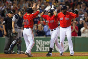 Yoenis Cespedes #52 of the Boston Red Sox celebrates with teammates David Ortiz and Daniel Nava after his 3-run home run against the Seattle Mariners during the sixth inning at Fenway Park on August 22, 2014 in Boston, Massachusetts.