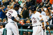Chris Carter #23 and Carlos Corporan #22 of the Houston Astros celebrate after Carter hit a home run in the second inning against the Seattle Mariners at Minute Maid Park on April 24, 2013 in Houston, Texas.