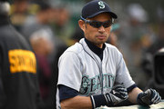 Ichiro Suzuki #51 the Special Assistant to the Chairman of the Seattle Mariners looks on from the end of the dugout prior to the start of the game against the Oakland Athletics at Oakland Alameda Coliseum on August 14, 2018 in Oakland, California.