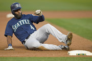 Denard Span #4 of the Seattle Mariners slides into third base with a triple against the Oakland Athletics in the top of the second inning at Oakland Alameda Coliseum on August 30, 2018 in Oakland, California.