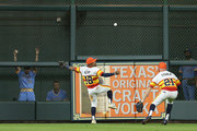 Tony Kemp #18 of the Houston Astros plays the ball off the wall as Derek Fisher #21 backs him up on a Nelson Cruz #23 of the Seattle Mariners double in ghe eighth inning at Minute Maid Park on August 10, 2018 in Houston, Texas.
