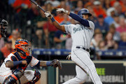 Denard Span #4 of the Seattle Mariners hits a home run in the second inning against the Houston Astros at Minute Maid Park on August 9, 2018 in Houston, Texas.