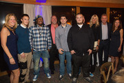 Marshawn Lynch, Joe Montana and Jennifer Montana pose for a photo with guests during the FAM 1st FAMILY FOUNDATION Charity Event at The Edgewater Hotel on December 14, 2014 in Seattle, Washington.