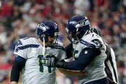 Offensive tackle Duane Brown #76 reacts with kicker Sebastian Janikowski #11 of the Seattle Seahawks after a third quarter field goal against the Arizona Cardinals at State Farm Stadium on September 30, 2018 in Glendale, Arizona.