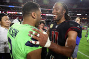 Wide receiver Larry Fitzgerald #11 of the Arizona Cardinals greets quarterback Russell Wilson #3 of the Seattle Seahawks following the NFL game at the University of Phoenix Stadium on November 9, 2017 in Glendale, Arizona.  The Seahawks defeated the Cardinals 22-16.