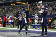 Doug Baldwin #89 of the Seattle Seahawks celebrates a fourth quarter touchow with Jimmy Graham #88 of the Seattle Seahawks against the Dallas Cowboys at AT&T Stadium on December 24, 2017 in Arlington, Texas.