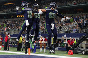 Paul Richardson #10 of the Seattle Seahawks, Doug Baldwin #89 of the Seattle Seahawks, and Jimmy Graham #88 of the Seattle Seahawks celebrate the touchdown by Baldwin against the Dallas Cowboys at AT&T Stadium on December 24, 2017 in Arlington, Texas.