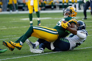 Randall Cobb #18 of the Green Bay Packers is tackled by Earl Thomas #29 of the Seattle Seahawks during the second half at Lambeau Field on September 10, 2017 in Green Bay, Wisconsin.