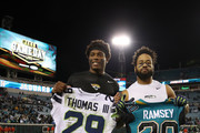 Jalen Ramsey #20 of the Jacksonville Jaguars (L) and  Earl Thomas #29 of the Seattle Seahawks exchange jerseys on the field after the Jaguars defeated the Seahawks 30-24 at EverBank Field on December 10, 2017 in Jacksonville, Florida.