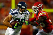 Tight end Jimmy Graham #88 of the Seattle Seahawks carries the ball after making a catch as free safety Husain Abdullah #39 of the Kansas City Chiefs defends during the preaseason game at Arrowhead Stadium on August 21, 2015 in Kansas City, Missouri.