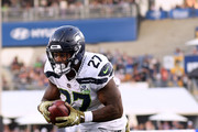 Mike Davis #27 of the Seattle Seahawks runs in a touchdown after his catch to trail 36-31 to the Los Angeles Rams during the fourth quarter at Los Angeles Memorial Coliseum on November 11, 2018 in Los Angeles, California.