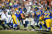 Running back Mike Davis #27 of the Seattle Seahawks runs up the middle in the second quarter at Los Angeles Memorial Coliseum on November 11, 2018 in Los Angeles, California.