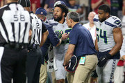 Defensive back Earl Thomas #29 of the Seattle Seahawks is assisted by team personel after an injury during the second half of an NFL game against the Arizona Cardinals at State Farm Stadium on September 30, 2018 in Glendale, Arizona.