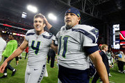 Kicker Sebastian Janikowski #11 and holder Michael Dickson #4 of the Seattle Seahawks walk off the field after kicking the game winning field goal against the Arizona Cardinals during an NFL game at State Farm Stadium on September 30, 2018 in Glendale, Arizona.