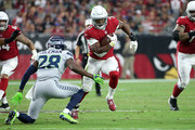 Running back David Johnson #31 of the Arizona Cardinals runs with the ball during an NFL game against the Seattle Seahawks at State Farm Stadium on September 30, 2018 in Glendale, Arizona.