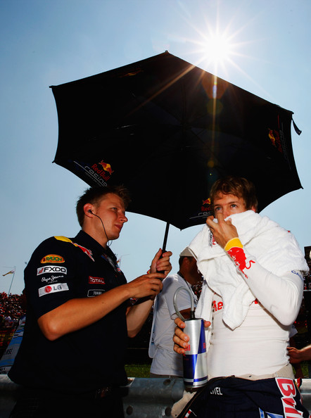 Sebastian Vettel Sebastian Vettel of Germany and Red Bull Racing and his trainer Tommi Parmakoski are seen before the Hungarian Formula One Grand Prix at the Hungaroring on August 1, 2010 in Budapest, Hungary.