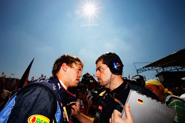 Sebastian Vettel Sebastian Vettel (L) of Germany talks with his Red Bull Racing race engineer Guillaume Rocquelin before the Hungarian Formula One Grand Prix at the Hungaroring on August 1, 2010 in Budapest, Hungary.