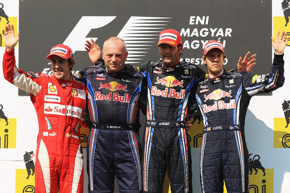 Sebastian Vettel (L-R) Second placed Fernando Alonso of Spain and Ferrari, Red Bull Racing mechanic Darren Nicholls, race winner Mark Webber of Australia and Red Bull Racing and third placed Sebastian Vettel of Germany and Red Bull Racing celebrate on the podium following the Hungarian Formula One Grand Prix at the Hungaroring on August 1, 2010 in Budapest, Hungary.
