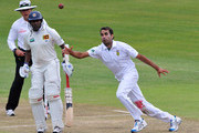 Imran Tahir of South Africa fields off his own bowling during day 1 of the 2nd Sunfoil Test match between South Africa and Sri Lanka at Sahara Park Kingsmead on December 26, 2011 in Durban, South Africa.