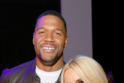 Michael Strahan and Nicole Mather attend the Christian Cowan front row in Gallery II during New York Fashion Week: The Shows - Day 7 at Spring Studios on September 10, 2019 in New York City.
