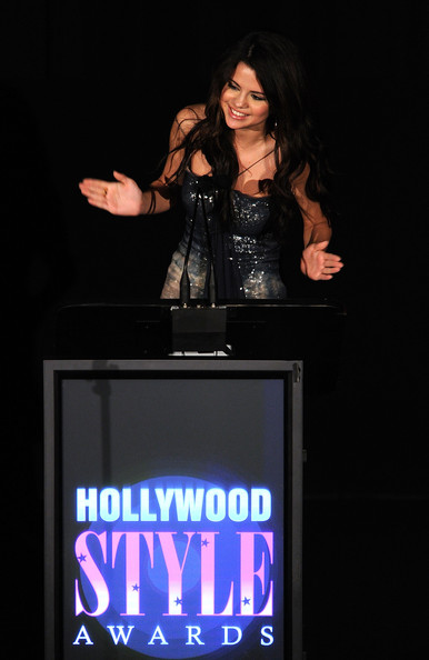 Selena Gomez Presenter Selena Gomez speaks onstage at the 2010 Hollywood Style Awards at the Hammer Museum on December 12, 2010 in Westwood, California.