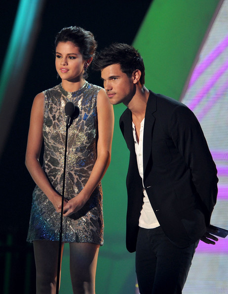 Selena Gomez Actors Selena Gomez (L) and Taylor Lautner speak onstage during the 2011 MTV Video Music Awards at Nokia Theatre L.A. LIVE on August 28, 2011 in Los Angeles, California.