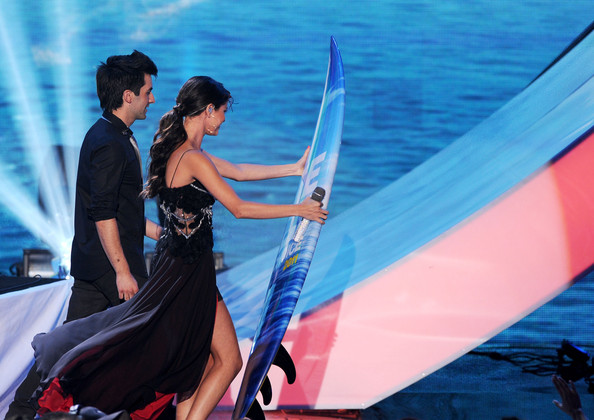 Selena Gomez Selena Gomez & The Scene accept the Choice Music Group award onstage during the 2011 Teen Choice Awards held at the Gibson Amphitheatre on August 7, 2011 in Universal City, California.