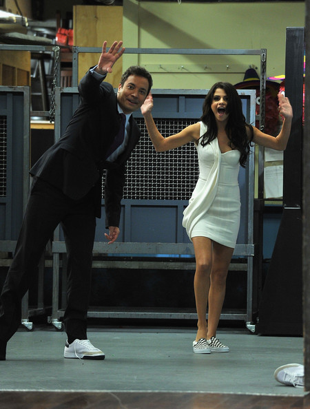 "Selena Gomez Jimmy Fallon and Selena Gomez play a game of ""Shoe Golf"" during a taping of ""Late Night With Jimmy Fallon"" at Rockefeller Center on June 23, 2011 in New York City."