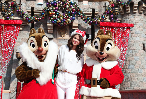 Selena Gomez In this handout image provided by Disney, 'Wizards of Waverly Place' star Selena Gomez meets Chip and Dale during the taping of the 2010 Disney Parks Christmas Day Parade on November 7, 2010 at Disneyland in Anaheim, California. The show airs Christmas Day, at various times across the country, on ABC. (Photo by Paul Hiffmeyer/Disney via Getty Images)..