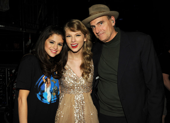 "Selena Gomez (L-R) Selena Gomez, Taylor Swift and James Taylor pose during the ""Speak Now World Tour"" at Madison Square Garden on November 22, 2011 in New York City. Taylor Swift wrapped up the North American leg of her SPEAK NOW WORLD TOUR with two sold-out shows at Madison Square Garden this week. In 2011, the tour played to capacity crowds in stadiums and arenas over 98 shows in 17 countries spanning three continents, and will continue in 2012 with shows Australia and New Zealand."