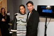 Jamie Chung and designer Han Chong pose backstage after the Self-Portrait Fall Winter 2020 fashion show on February 08, 2020 in New York City.