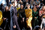Olivia Palerma (L) Angela Sarafyan and Greta Lee attend the Self-Portrait front row during New York Fashion Week: The Shows at Gallery I at Spring Studios on February 9, 2019 in New York City.