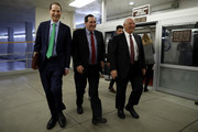 Sen. Ron Wyden (D-OR), at left, Sen. Joe Donnelly (D-IN), center, and Sen. Ben Cardin (D-MD), at right, walk to a Democratic Caucus meeting at the U.S. Capitol January 19, 2018 in Washington, DC. A continuing resolution to fund the government has passed the House of Representatives but faces a stiff challenge in the Senate.
