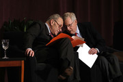 U.S. Senate Majority Leader Mitch McConnell (right) (R-KY) and U.S. Senate Democratic Leader Chuck Schumer (D-NY) speak to each other while waiting on stage at the University of Louisville's McConnell Center where Schumer was scheduled to speak February 12, 2018 in Louisville, Kentucky. Sen. Schumer spoke at the event as part of the Center's Distinguished Speaker Series, and Sen. McConnell introduced him.