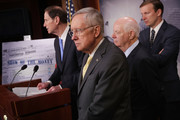 Senate Minority Leader Harry Reid (D-NV) (2nd L) is joined by (L-R) Sen. Ron Wyden (D-OR), Sen. Ben Cardin (D-MD) and Sen. Chris Murphy (D-CT) to call on Republicans to hold a vote on the Presidential Tax Transparency Act at the U.S. Capitol September 22, 2016 in Washington, DC. The proposed legislation would require presidential candidates to 'release their tax returns shortly after becoming the official nominees of their parties.'