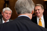 Former Sen. Bob Graham  (D-FL) (L) and William Reilly (R), co-chairmen of the National Commission on the BP Deepwater Horizon Oil Spill and Offshore Drilling, talk with Sen. Tom Carper (D-DE) after testifying on Capitol Hill on March 16, 2011 in Washington, DC. The commission issued its report shortly before the one year anniversary of the Gulf Oil Spill on April 20, 2010.