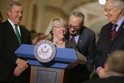 Sen. Charles Schumer (D-NY) (3rd L) shares a laugh with Sen. Patty Murray (D-WA) during a news conferece with Senate Minority Whip Richard Durbin (D-IL) (L) and Senate Minority Leader Harry Reid (D-NV) following the weekly Senate Democratic policy luncheon in the U.S. Capitol December 8, 2015 in Washington, DC. The government is slated to run out of spending authority on December 11 and Republican and Democratic leaders are at an impasse over an omnibus spending bill.