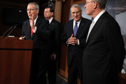 (L-R) U.S. Senate Minority Leader Sen. Mitch McConnell (R-KY) speaks as Sen. John Barrasso (R-WY), Senate Minority Whip Sen. Jon Kyl (R-AZ), and Sen. Lamar Alexander (R-TN) listen during a news conference July 12, 2011 on Capitol Hill in Washington, DC. McConnell discussed the ongoing budget and debit limit negotiations with the administration and proposed a new solution for the administration to raise the debt  ceiling.